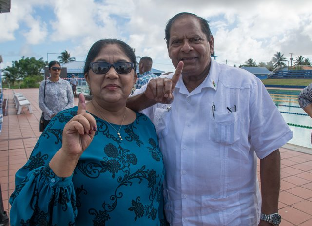 We have voted. Prime Minister, Hon. Moses Nagamootoo and wife, Sita Nagamootoo display inked fingers to indicate they have voted in the General and Regional Elections.