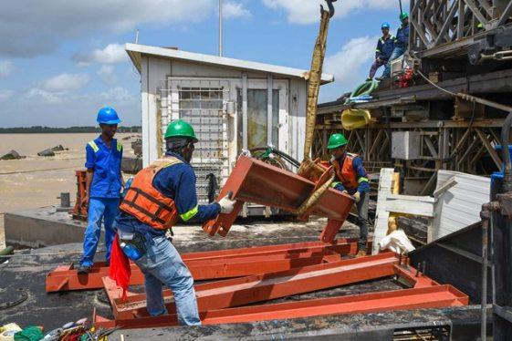 Workmen on the Demerara Harbour Bridge.