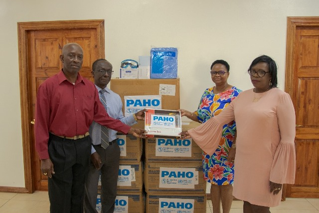 PAHO hands over PPEs:(from left to right) Coordinator, HEOC, Dr. Collin James, PAHO/WHO Country Representative, Dr. William Adu-Krow, Minister of Public Health, Volda Lawrence and Permanent Secretary, MoPH, Colette Adams.