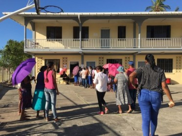 Residents of Port Mourant wait to cast their vote at the Berbice Islamic School, in Port Mourant.