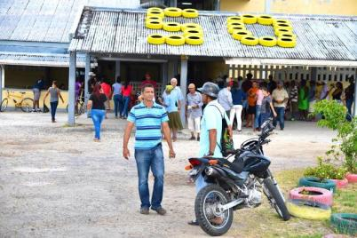 Voters at the West Demerara Secondary School polling station.