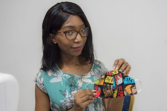 """Designer Akeisha Cave displays a mask made for her """"Face Mask Sewing Project""""."""