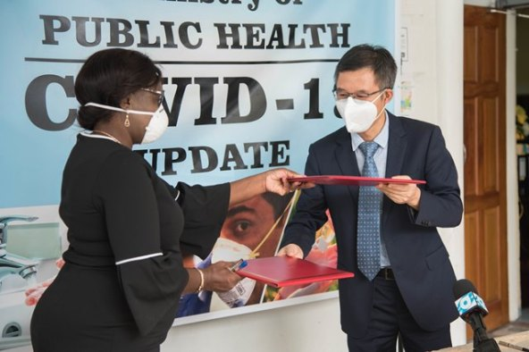 Deputy Chief of Mission at the Chinese Embassy, Chen Xilai and Permanent Secretary (PS) of the Ministry of Public Health Collette Adam at the handing over ceremony.