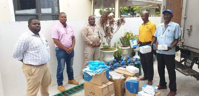 Doctors attached to the Kwakwani Hospital and Regional Officials with some of the supplies sent to the hospital by the MoPH