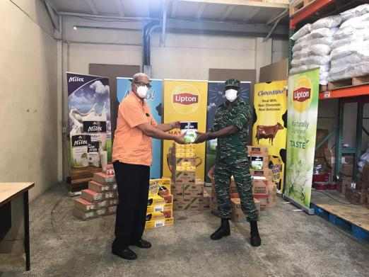 CEO of DeSinco Trading Limited Frank DeAbreu hands over the donates supplies to Director-General of Civil Defense Commission (CDC), Lieutenant Colonel Kester Craig