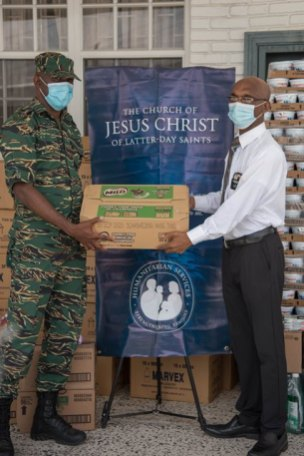 (left to right) Director-General Lieutenant Colonel Kester Craig receiving the donation from President of the Church of Jesus Christ of Latter-day Saints Wayne Barrow