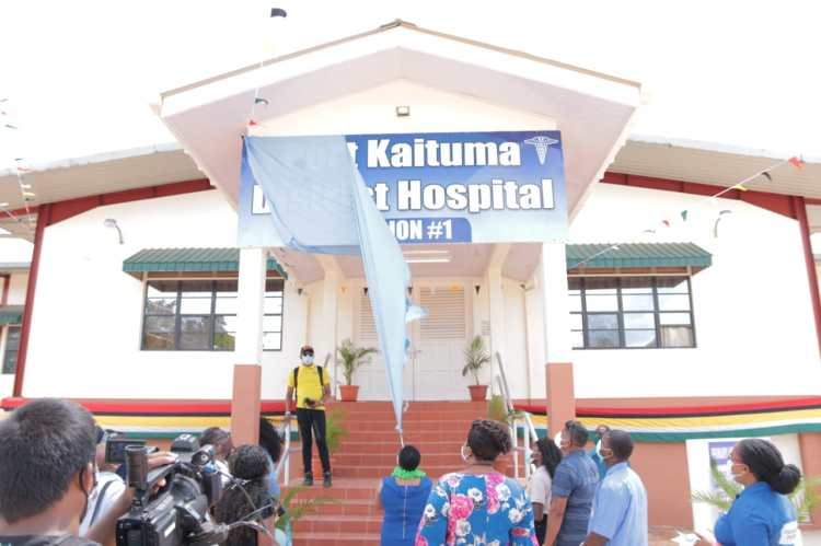 Minister of Public Volda Lawrence unveils the sign to officially commission the new Port Kaituma Hospital