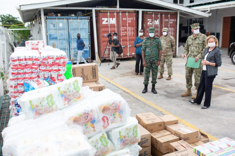 US Ambassador to Guyana, Sarah Ann Lynch and Director-General of the CDC, Lieutenant Colonel Kester Craig inspect the supplies.