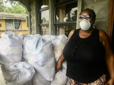 Dawn Benjamin of the Guyana Association for the Blind-Berbice Chapter and the Disabled Peoples Network, Region 6 with some of the hampers that will be given to members