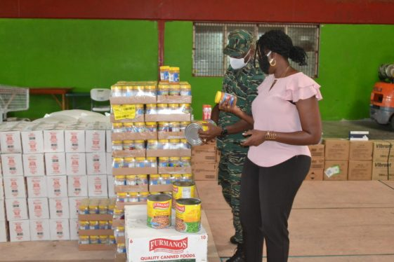 Director General of the CDC, Lt. Col. Kester Craig and Coordinator of the Ministry of Public Health's Elderly Health Unit, Dr. Melissa Dehaarte inspecting the donated items