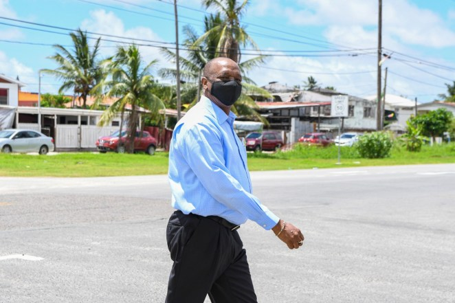 Former Director General of the Ministry of the Presidency and Election Agent for the APNU+AFC Joseph Harmon making his way to the Arthur Chun Conference Centre