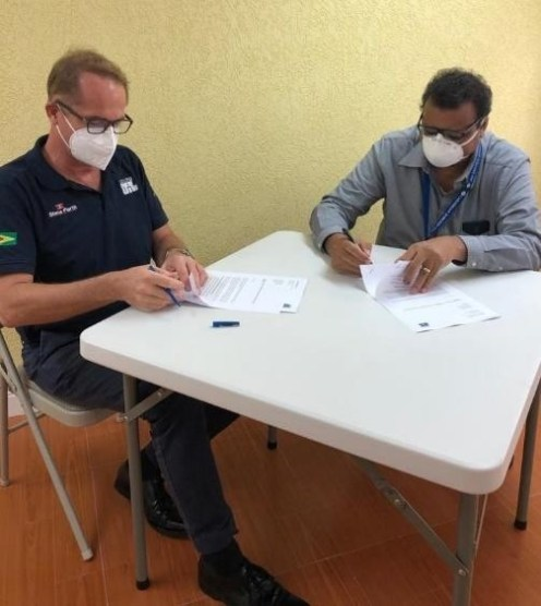 Dr. Surendra Persaud, Director/ General Surgeon CSI signs donation agreement with Joachim Vogt, Tullow Country Manager