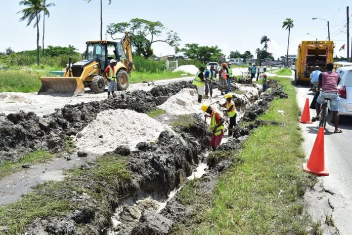 GWI workers laying new pipelines along Cemetery Road