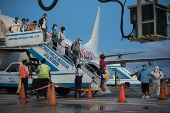 Returning Guyanese disembarking the Caribbean Airline flight