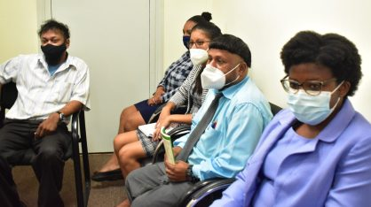 Members of staff of the Ministry of Amerindian Affairs, listening to Minister Sukhai during the engagement.