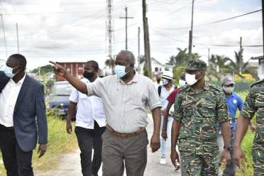 Prime Minister, Hon. (ret'd) Brigadier Mark Phillips accompanied by the Director-General of the CDC Lieutenant Colonel Kester Craig heading to the conduct the site assessment of the commission's headquarters