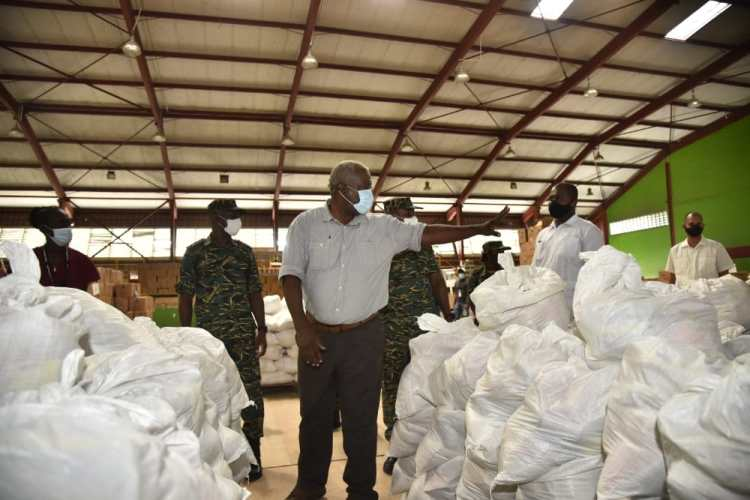 Prime Minister, Hon. (ret'd) Brigadier Mark Phillips inspecting some of the COVID relief hampers