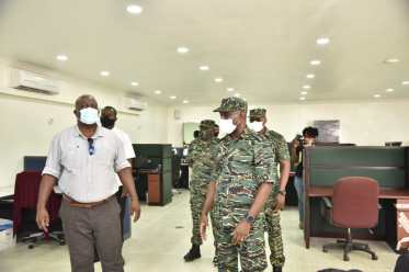 Prime Minister, Hon. Hon. (ret'd) Brigadier Mark Phillips during his inspection of the CDC's headquarters
