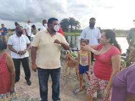 His Excellency, Dr, Mohamed Irfaan Ali, greets residents in keeping with the health and safety protocols.