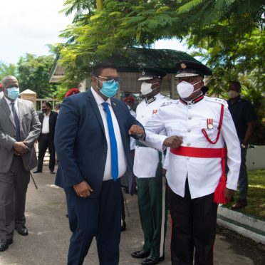 9th Executive President of Guyana of His Excellency Dr. Mohammad Irfaan Ali of the Cooperative Republic of Guyana greets Fire Chief Marlon Gentle on arrival to the Inauguration Ceremony at the National Cultural Centre (NCC)