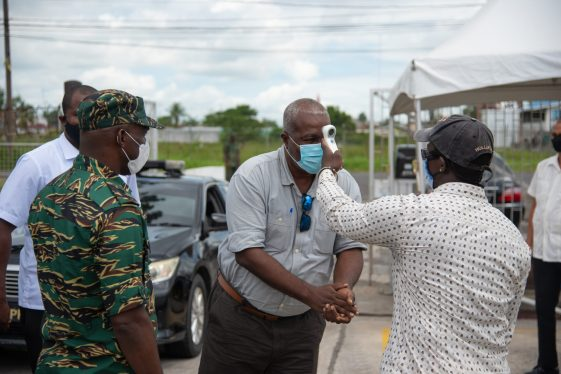 Prime Minister Phillips checking his temperature at CDC's Headquarters