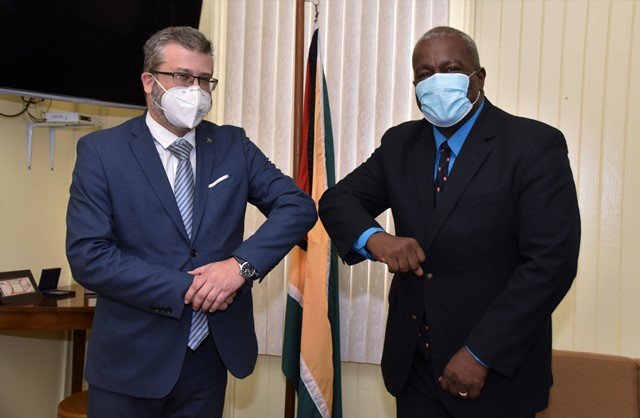 Prime Minister Brigadier Mark Phillips (right), greets Ambassador of the Delegation of the European Union to Guyana, Mr. Fernando Ponz Canto during the courtesy call