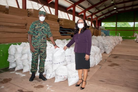 Minister of Amerindian Affairs, Hon. Pauline Sukhai, receives the hampers from Director-General of the Civil Defense Commission (CDC), Lieutenant Colonel, Kester Craig.