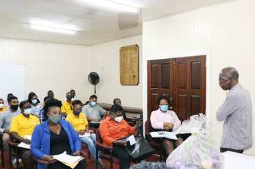 Minister of Labour, Hon. Joseph Hamilton, and staff of the Ministry of Labour, during their first meeting.
