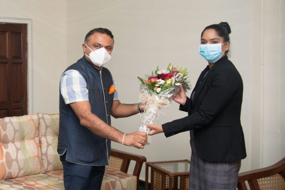 Minister of the Public Service, Hon. Sonia Parag, receives a token from the Indian High Commissioner, His Excellency, Dr. K.J. Srinivasa