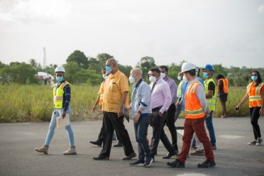 Public Works Minister, Hon. Bishop Juan Edghill and Minister with in the Ministry , Hon. Deodat Indar during the inspection of the CJIA.