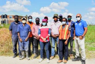 Minister within the Ministry of Housing and Water, Hon. Susan Rodrigues and her team in Lust-en-Rust