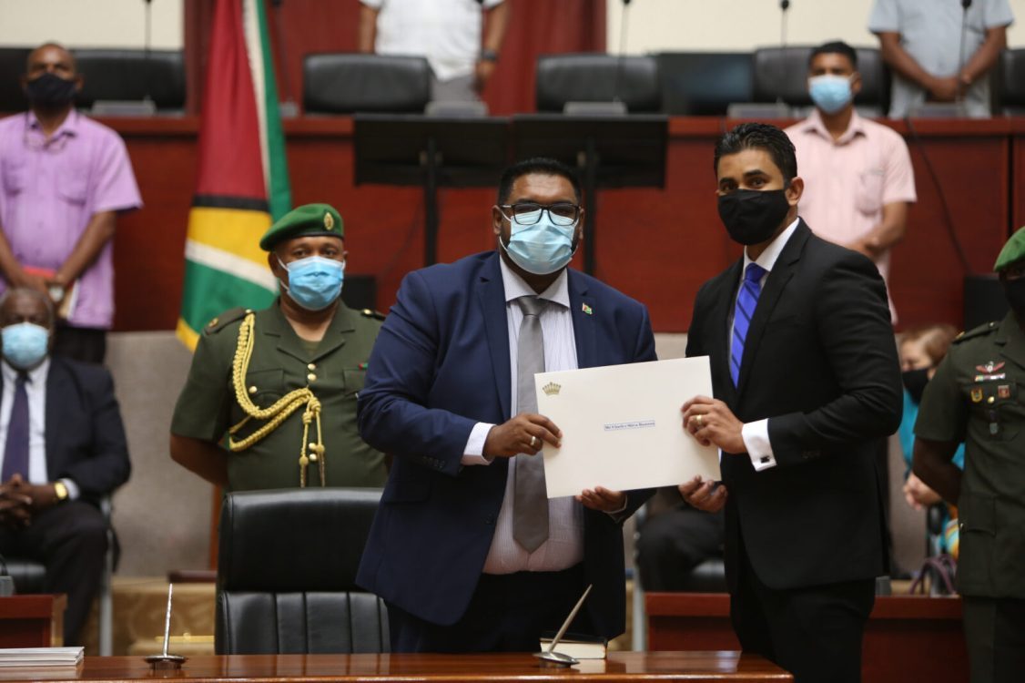 Minister of Culture, Youth and Sport, Hon Charles Ramson Jr. accepts his Instruments of Appointment form President Mohamed Irfaan Ali