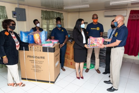 (left to right) Minister of Human Services and Social Security, Hon. Dr. Vindhya Persaud receives the donation from President of the Rotary Club of Georgetown, Mr. Clyde de Haas as Club members look on.