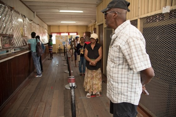 Pensioners line up to receive their payments