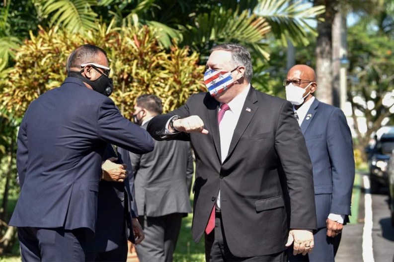 Foreign Secretary Robert Persaud greets U.S. Secretary of State Michael Pompeo at State House