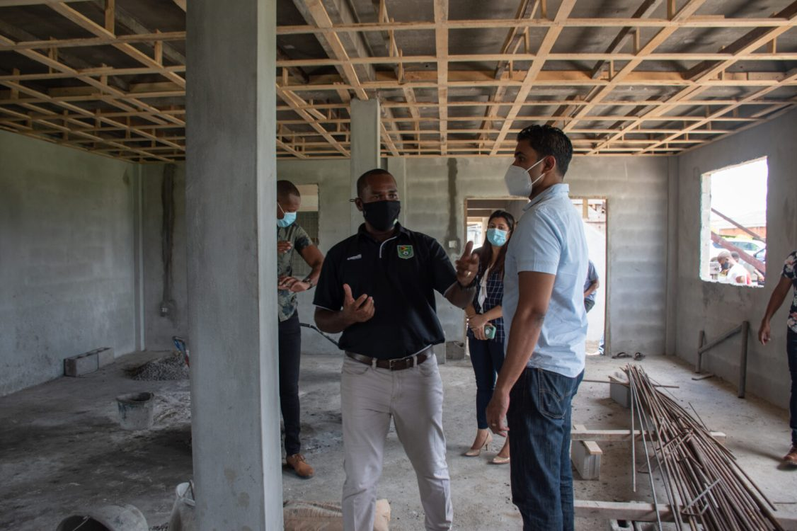 GFF President, Wayne Forde and Minister Ramson look at the designated gym area, which is still under construction