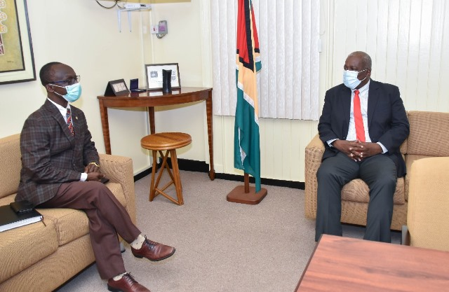 Prime Minister Brigadier Mark Phillips pays keen attention to PAHO/WHO Country Representative, Dr. William Adu- Krow as he makes a point during their meeting today.