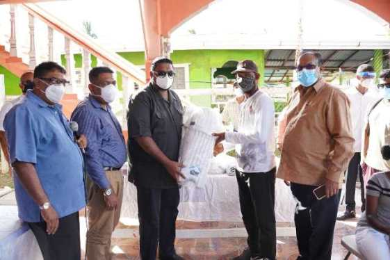 President Dr. Mohamend Irfaan Ali presents a quantity of sporting gear to several cricket clubs in the East Berbice -Corentyne (Region Six)