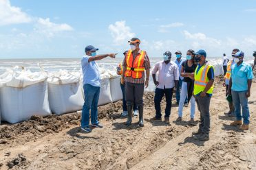 Minister of Public Works, Hon. Bishop Juan Edghill pays keen attention as the contractor explains the work plan for the rehabilitation works at the Dantzig and Fairfield foreshores