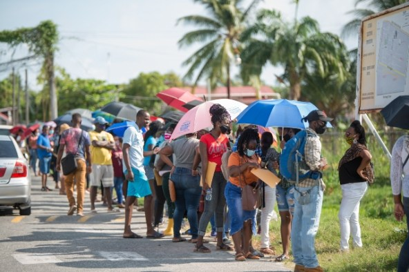 Residents lined up in front of the Chateau Margot Primary School