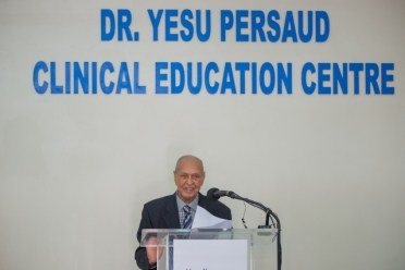 Dr. Yesu Persaud delivering his remarks at the ceremony.