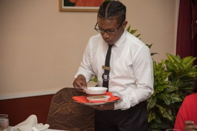 Waiter providing service