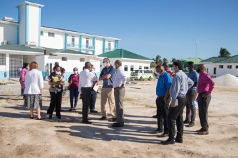 Minister of Health, Hon. Dr. Frank Anthony with GPHC staff, contractors and representative of the US Army Humanitarian Assistance Programme, outside the Centre for Disease Control and Prevention at Liliendaal.