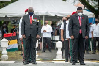 President, Dr. Mohamed Irfaan Ali and Prime Minister Hon. Brigadier (ret'd) Mark Phillips observe two minutes silence in honour of the fallen heroes.