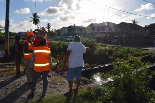 Minister Edghill listens to the concerns of residents in Enmore concerning a bridge being constructed by the Region