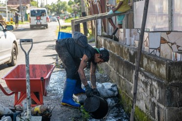 Men at work in Albouystown