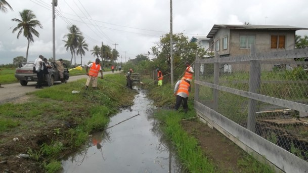 Some Community Enhancement Workers under the Community Infrastructure Improvement Project (CIIP) cleaning drains