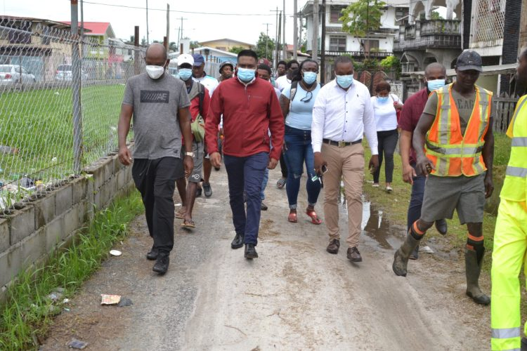 Minister of Local Government and Regional Development Hon. Nigel Dharamlall and his team walk through Albouystown to inspect ongoing community enhancements