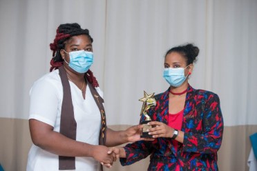 : Critical Care Nurse Ms. Janette Thomas receives her certificate from Health Sciences Education Director, Ms. Seraiah Validum.