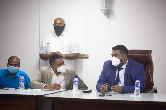 President Dr. Mohamed Irfaan Ali and Minister of Local Government and Regional Development, Hon. Nigel Dharamlall in discussions in the Boardroom of the Region Two RDC during the outreach